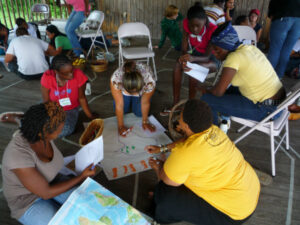 Seeds of Fire campers share their experiences and strategize together.