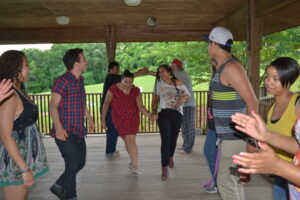 Our wacky workshoppers enjoy an old-fashioned Highlander square dance.  Photo by Donald Jones.